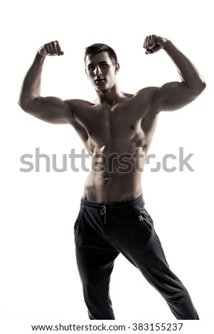 Muscular man posing, flexing his biceps, showing perfect body.  - stock photo