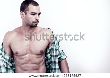 Muscular man posing in studio shirtless. - stock photo