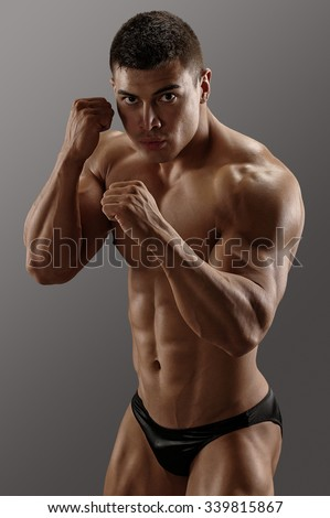 Muscular man ready to fight  - stock photo