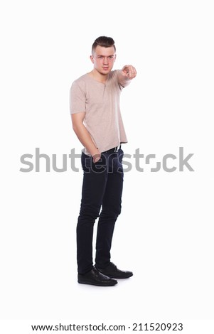 Muscular man showing you, isolated on white background - stock photo