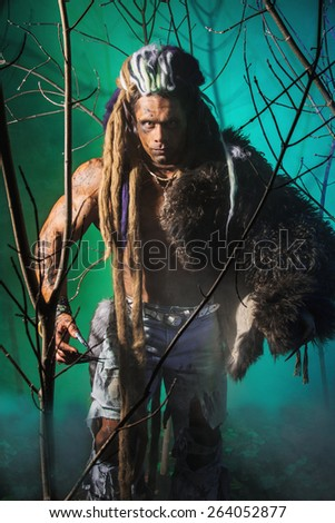 Muscular man werewolf goes through the woods. - stock photo