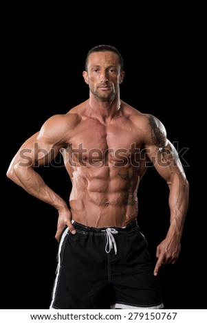 Muscular Mature Man Posing In Studio - Isolated On Black Background - stock photo