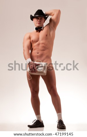 Muscular naked male stripper with ladie's purse - stock photo