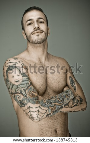 Muscular Sexy Man with tattoo - stock photo