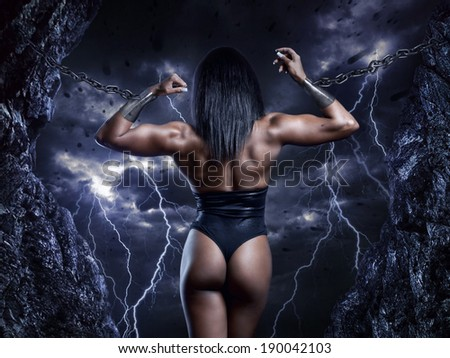 Muscular strong woman prisoner - stock photo