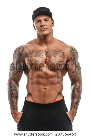 Muscular tattooed shirtless guy isolated on white background - stock photo