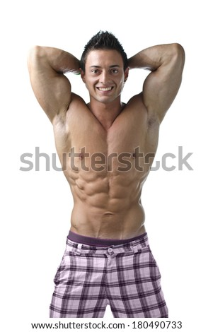 Muscular young bodybuilder showing biceps and ripped abs, smiling. Isolated on white - stock photo