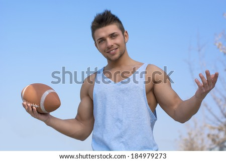 Muscular young construction worker shirtless looking at his bulging bicep - stock photo