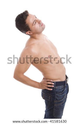 Muscular young man clutching his lower back, suffering from back pain. - stock photo