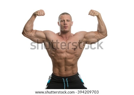 Muscular Young Man Posing In Studio - Isolated On White Background - stock photo