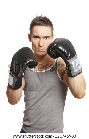 Muscular young man with boxing gloves in sports outfit on white background - stock photo