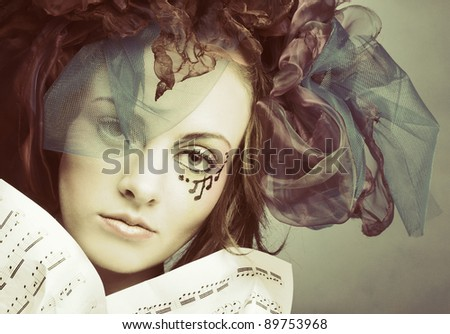 Muse. Young pretty woman in fantastic image with note's. - stock photo