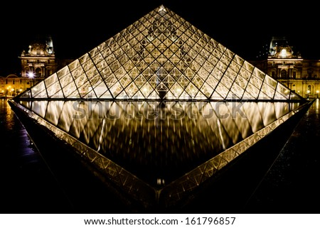 Musee Louvre in Paris by night - stock photo