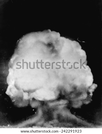 Mushroom cloud seen six miles away following the detonation of the first atomic bomb, July 16, 1945, in the New Mexico desert. - stock photo