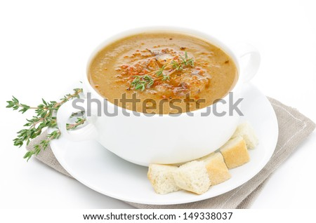 Mushroom soup in a bowl with croutons and thyme isolated on white background - stock photo