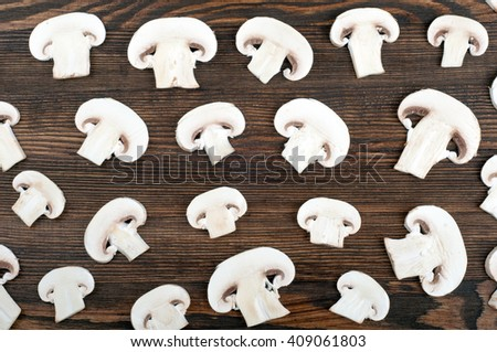 Mushrooms on wooden rustic background. Food background. Top view - stock photo