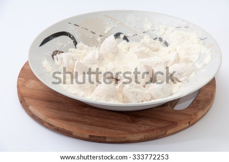 Mushrooms poached in flour prepared for frying. - stock photo