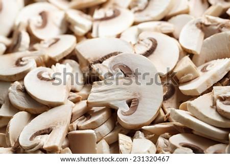 Mushrooms sliced for frying. - stock photo