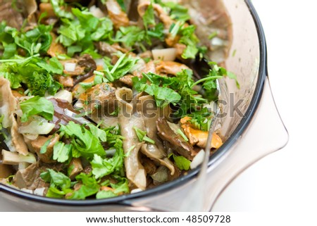 mushrooms with greens in the bowl - stock photo