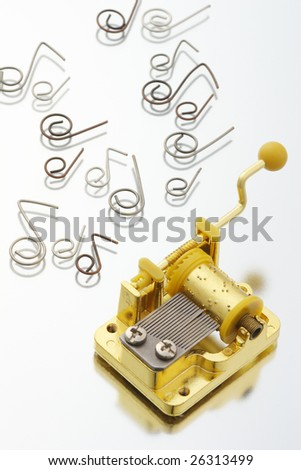 Music box with music notes reflected in the mirror - stock photo