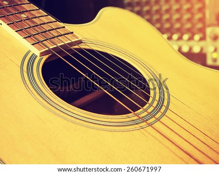Music concept : Classic guitar with sound mixer  control background in vintage style. - stock photo