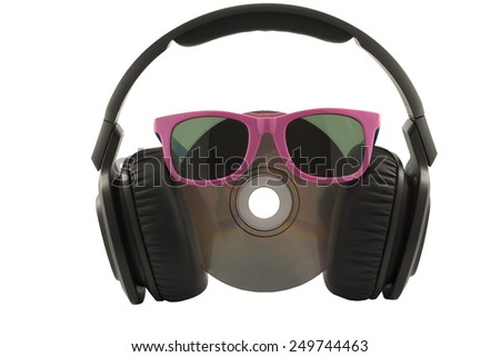 music concept, headphone and cd with sun glasses on white background - stock photo