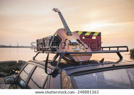 Music instrumental guitar car outdoor background - stock photo