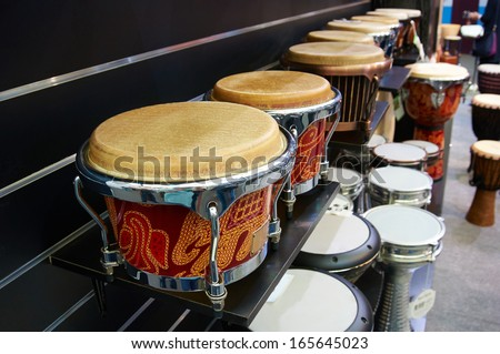 Music Instruments, Drums on shelf - stock photo