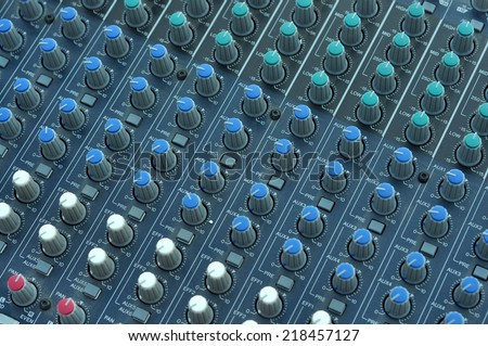 Music mixer desk buttons top view perspective - stock photo