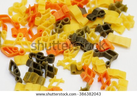 music pasta in the form of notes and treble clef - stock photo