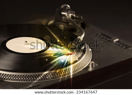 Music player playing vinyl with glow lines comming from the needle concept on background - stock photo