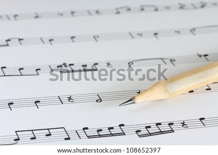 music sheet with pencil - stock photo