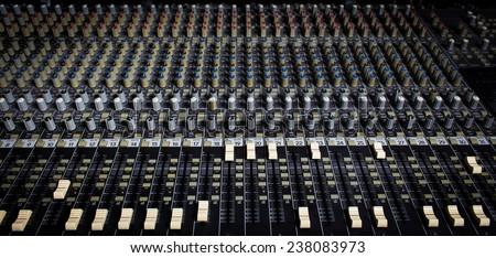 music & sound studio recording mixer, mixing board - stock photo