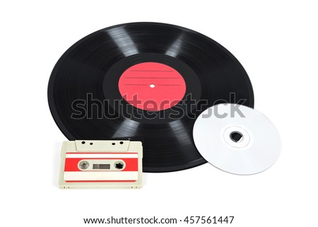 Music storage devices - vinyl record, analog cassette and CD isolated on white background with clipping path - stock photo