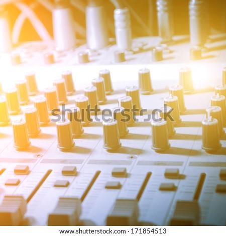 Music studio, sound studio adjusting record equipment - stock photo