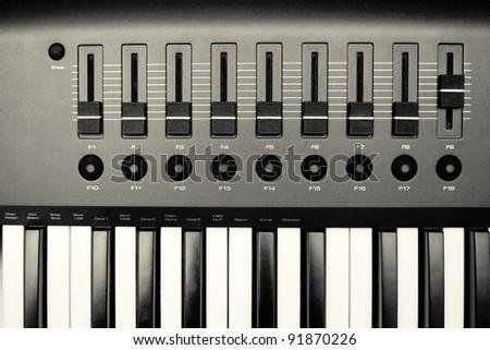 Music Synthesizer closeup. keyboard and controls. - stock photo