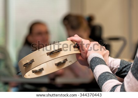 Music therapy for disabled children playing in a group / Working with mentally handicapped people - stock photo