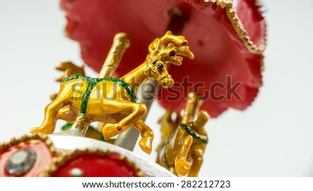 Musical carousel deer with Christmas theme decoration. Concept of classic Christmas holiday gift spirit. Isolated on empty background. Selective defocused and close up shot. Copy space - stock photo