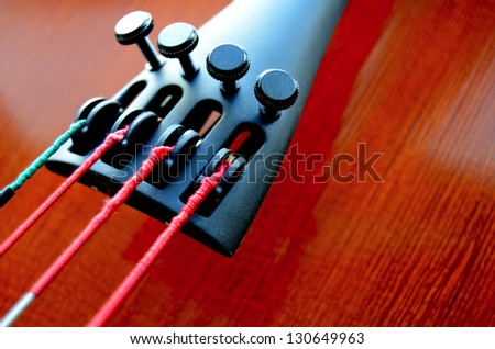 Musical Close-Up Of Strings And Tailpiece Of A Cello With Copy Space - stock photo