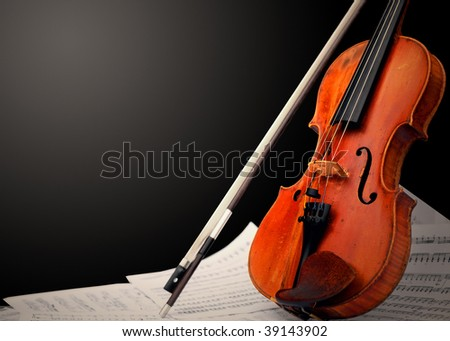 Musical instrument ? violin and notes - stock photo
