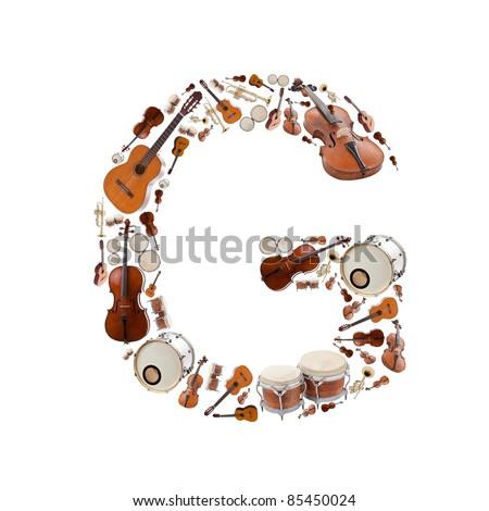 Musical instruments alphabet on white background. Letter G - stock photo