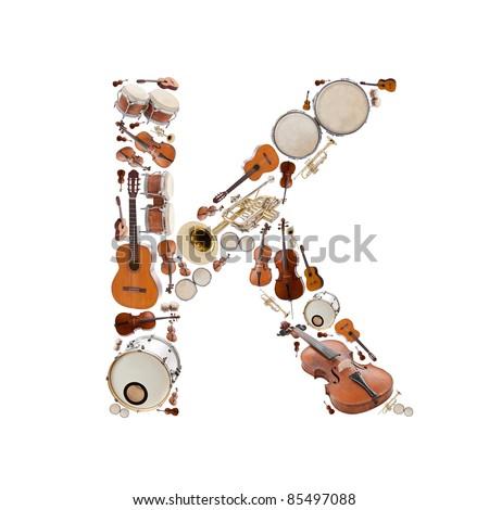 Musical instruments alphabet on white background. Letter K - stock photo