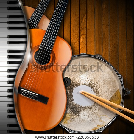 Musical Instruments Background / Two acoustic guitars, piano keyboard and metallic old snare drum against a rustic wood background. Concept of music performance - stock photo