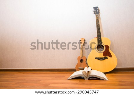 musical instruments guitar ukulele and heart book with effect vintage style - stock photo