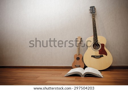 musical instruments guitar ukulele and song book with vintage effect - stock photo