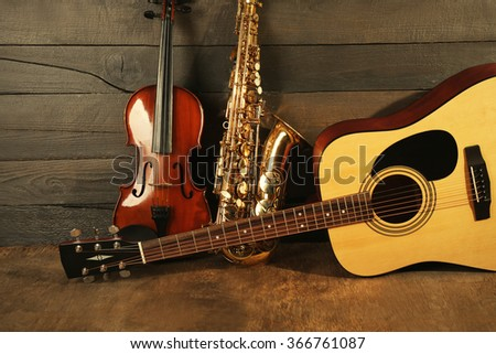 Musical instruments on wooden background - stock photo