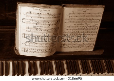 musical (It is surrounded with sounds) sepia - stock photo