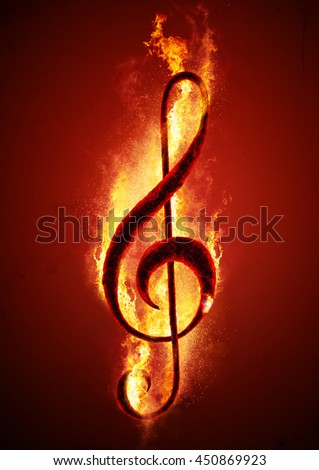 Musical note (treble clef) from hot charcoal on fire. Conceptual image of hot music. - stock photo
