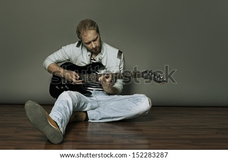 musician guitar tunes - stock photo