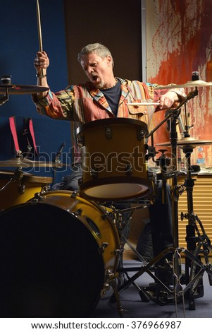 musician happy playing drums in his music Studio - stock photo